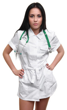 a lady doctor: Beautiful sexy nurse standing and posing on white background. Looking at camera.