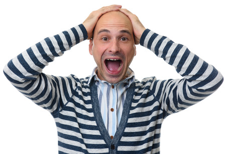 man shocked to madness with his hands on head. Isolated on white.