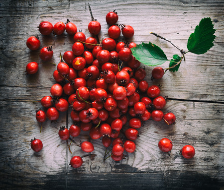 Hawthorn berries on a wooden background. Top view Stock Photo