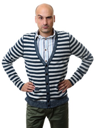 quizzical: confused guy with raised eyebrow and his hands on hips. Isolated on white background