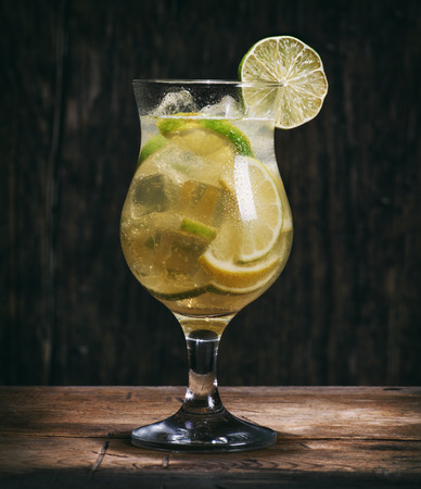 citrus cocktail with lime, lemon and ice cubes