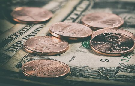 macro of coins and us dollars close up Stock Photo