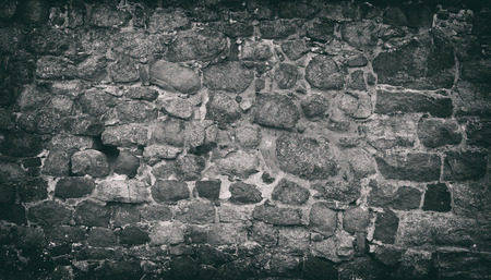 stacked stone: Stacked Stone Wall background. Old grunge texture