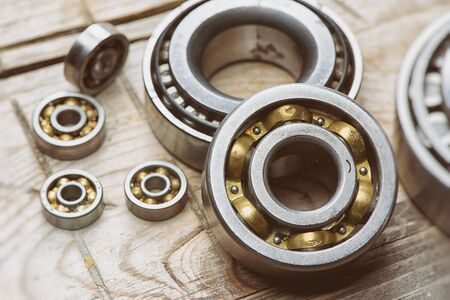 old bearings on a wooden background close up