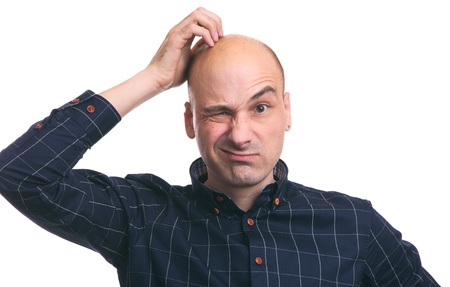 Confused bald guy scratch his head. Isolated on white