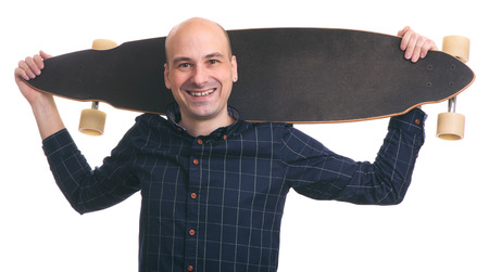portrait of bald stylish man with longboard. Isolated on white background photo