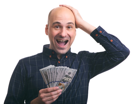 Surprised happy man holds a lot of money. Isolated photo