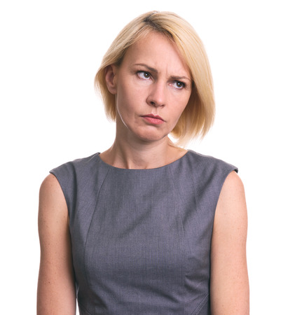 Portrait of angry woman looking away isolated on white background