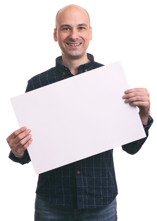 young man holding a blank banner. Isolated on white photo