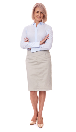 full length portrait of a middle aged business woman. Isolated on white Stock Photo