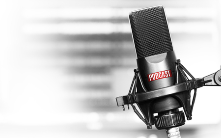 Professional microphone with podcast on a stand in radio studio 写真素材