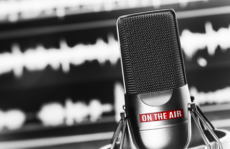 Professional studio microphone attached to shock mount with on the air sign Stock Photo