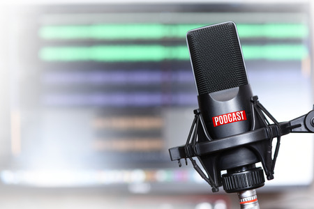 studio microphone with a podcast icon close up