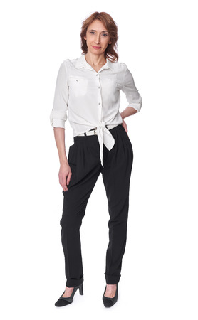full body portrait of an elegant middle aged woman wearing casual clothes. Isolated on white