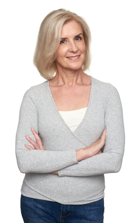 portrait of beautiful older blonde woman smiling and wearing casual clothes. Isolated on white background