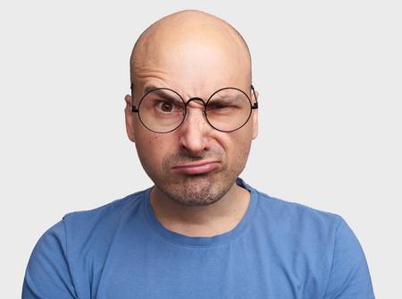 Grumpy man raising eyebrow, portrait Stock Photo