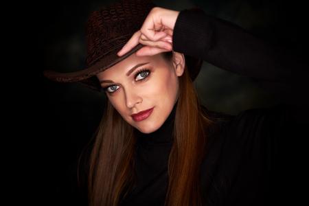 pretty girl wearing cowboy hat. Studio portrait 写真素材