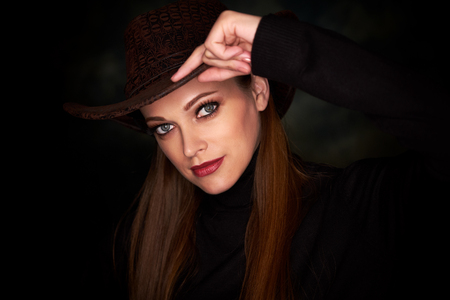 pretty girl wearing cowboy hat. Studio portrait Stok Fotoğraf