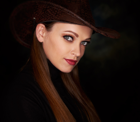 beautiful girl in cowboy hat. Studio portrait of pretty woman