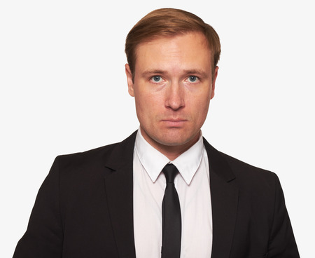 portrait of a businessman looking at camera isolated on white . Front view of handsome man wearing black suit. Studio shot.