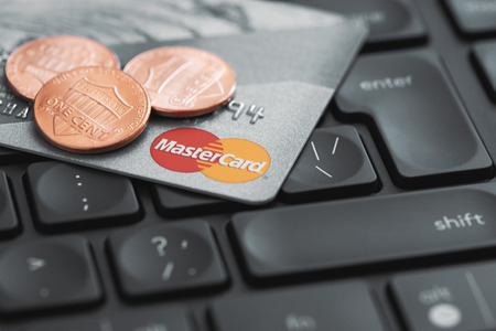 Moscow, Russia - September 20, 2018: Mastercard credit plastic card on computer keyboard