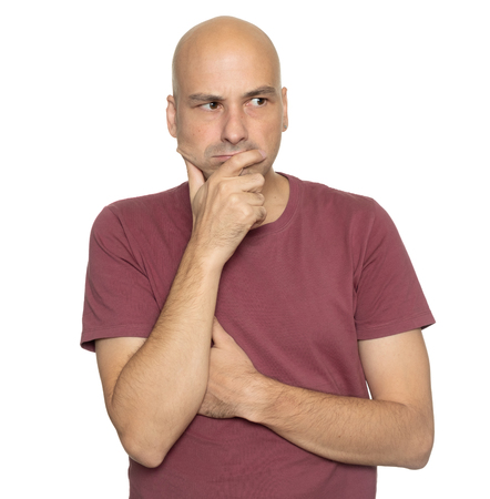 Serious bald man thinking looking aside isolated on white background Imagens - 117343999