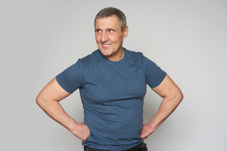 50 years handsome man looking away. Isolated on grey 版權商用圖片