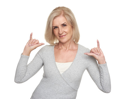 Happy senior woman. 50 years blonde lady isolated on white background