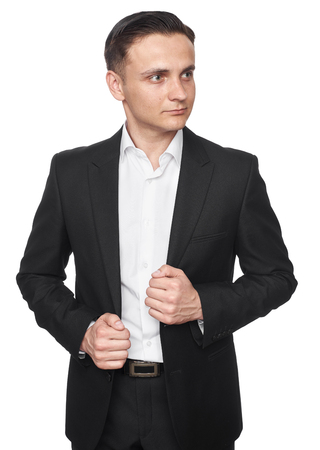 Young handsome man in black suit looking away isolated on white background