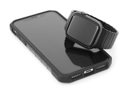 smartphone and smartwatch on a white background Stock Photo