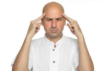40 years old bald man with headache. Isolated on white Reklamní fotografie
