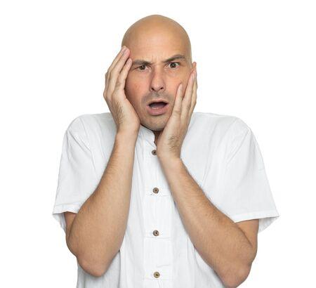 Shocked bald guy isolated on white background