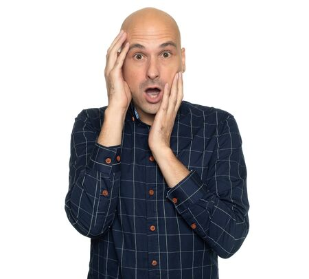 Shocked 40 years old bald man isolated on white
