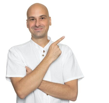 Bald man is pointing finger isolated on white background
