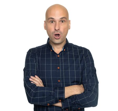 Surprised bald man isolated on white background