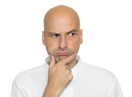 Serious bald man is thinking isolated on white