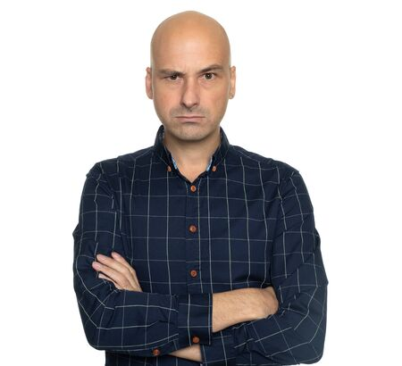 Angry bald man with hands folded isolated on white