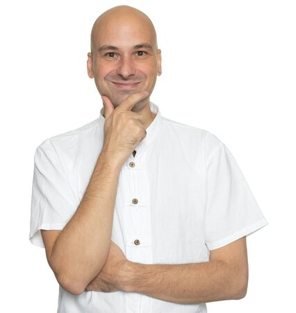 Handsome bald man in white shirt is smiling. Isolated