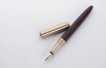 Fountain writing pen on a white paper sheet