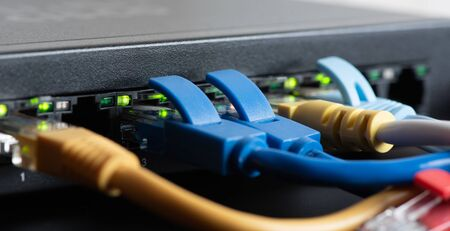 cables connected to network switch, close up