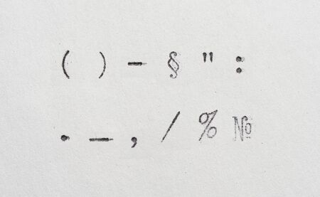 punctuation marks from typewriter. Vintage font on white paper