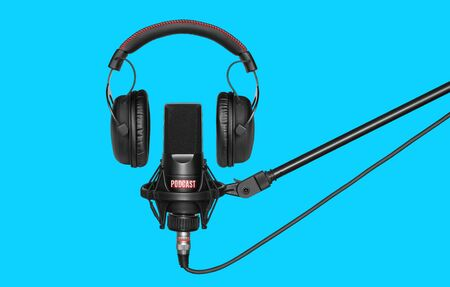 microphone and headphones for recording podcasts over blue background