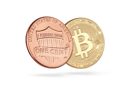 Golden bitcoin with one cent coin isolated on white background. Cryptocurrency and blockchain technology
