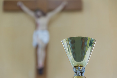 sacraments: Chalices,Jesus blurred background Stock Photo