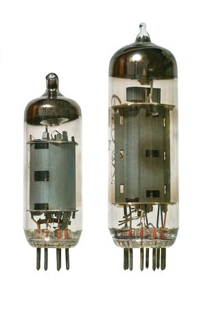 Big and small glass vacuum radio tubes. Isolated image on white background photo