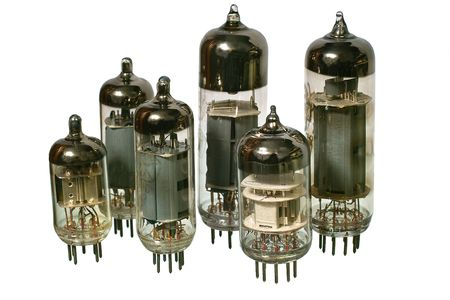 Varisized glass vacuum radio tubes. Isolated image on white background Stock Photo