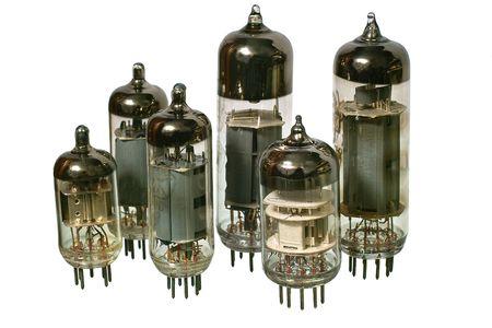 Varisized glass vacuum radio tubes. Isolated image on white background photo