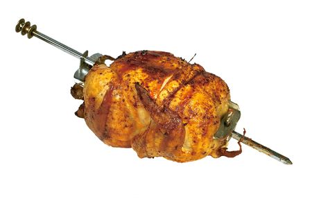 Roasted chicken on skewer isolated on white background Stock Photo