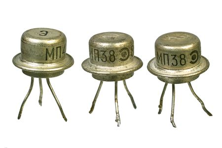 radio unit: Tree vintage electronic transistors isolated on white background Stock Photo