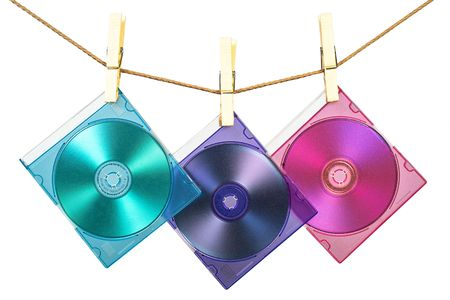 fixed line: Three CDs in colorful cases fixed with pins on the line
